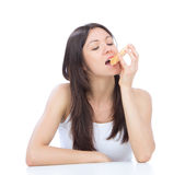 Woman enjoy sweet donut. Unhealthy junk food Royalty Free Stock Images