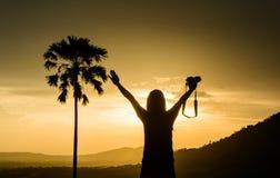Woman enjoy to take a photo Royalty Free Stock Image