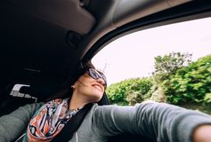 Woman enjoy with view from car window in traveling by auto Stock Image