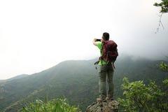 Woman enjoy the view at mountain peak Royalty Free Stock Image