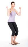 Woman enjoy weigh herself Stock Image