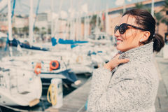 Woman enjoy with windy sunny spring day in the sea harbor Stock Photo