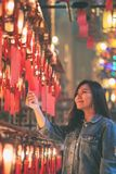Woman enjoyed looking at red lamps and wishes in Chinese temple royalty free stock photos