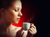 Woman Enjoying A Hot Cup Of Coffee On A Dark Background Stock Photography