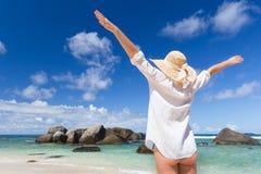 Woman enjoying Anse Lazio picture perfect beach on Praslin Island, Seychelles. Royalty Free Stock Images