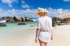 Woman enjoying Anse Lazio picture perfect beach on Praslin Island, Seychelles. Stock Photo