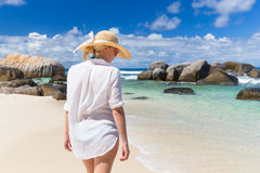 Woman enjoying Anse Lazio picture perfect beach on Praslin Island, Seychelles. Royalty Free Stock Photography