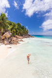 Woman enjoying Anse Patates picture perfect beach on La Digue Island, Seychelles. Stock Images