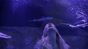 Woman enjoying aquarium view. stock footage