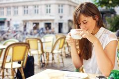 Woman Enjoying the Aroma of Her Coffee Stock Photo