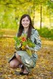 Woman enjoying the autumn fall Stock Photography