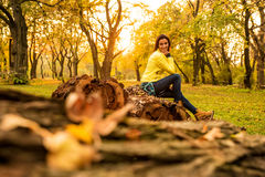 Woman enjoying the autumn in the forest Stock Images