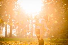 Woman enjoying autumn sunset Stock Photos