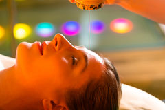 Woman enjoying a Ayurveda oil massage Royalty Free Stock Photography