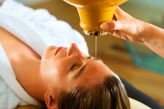 Woman enjoying a Ayurveda oil massage Stock Photography