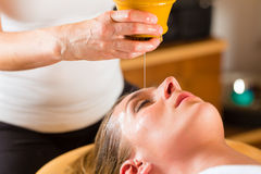 Woman enjoying a Ayurveda oil massage. Treatment in a spa royalty free stock photo