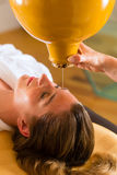 Woman enjoying a Ayurveda oil massage Royalty Free Stock Image