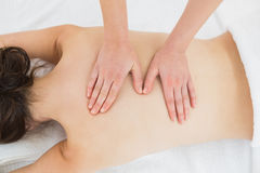 Woman enjoying back massage at beauty spa Royalty Free Stock Photo