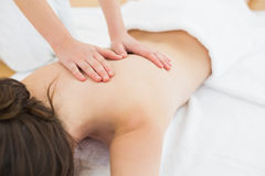 Woman enjoying back massage at beauty spa Royalty Free Stock Image