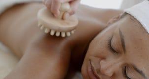 Woman Enjoying A Back Massage Royalty Free Stock Image