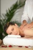 Woman enjoying a back massage. At a day spa Royalty Free Stock Photos