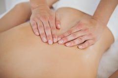 Woman enjoying a back massage Stock Images
