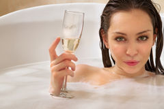 Woman is enjoying a bath royalty free stock photography