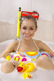 Woman is enjoying a bath in mask with snorkel. stock images