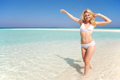 Woman Enjoying Beach Holiday Stock Photo