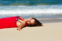 Woman enjoying beach sunbath royalty free stock photos