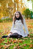 Woman enjoying beautiful autumn day. Young woman enjoying beautiful autumn day stock photography