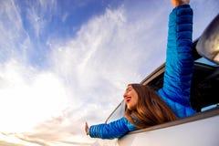 Woman enjoying beautiful cloudscape Stock Images