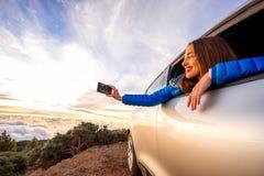 Woman enjoying beautiful cloudscape Royalty Free Stock Photos