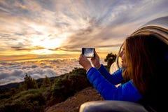 Woman enjoying beautiful cloudscape Stock Photos