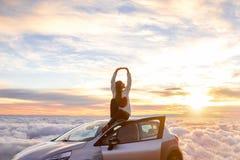 Woman enjoying beautiful cloudscape Royalty Free Stock Photography