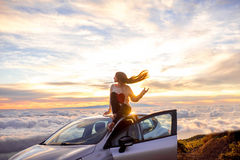 Woman enjoying beautiful cloudscape Royalty Free Stock Photo