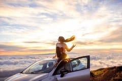 Woman enjoying beautiful cloudscape Royalty Free Stock Photo