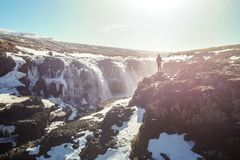 Woman enjoying the beautiful Kolugljúfur Canyon and waterfall, in Iceland stock photo
