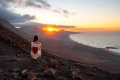 Free Woman Enjoying Beautiful Landscape On Fuerteventura Island Stock Image - 67751101