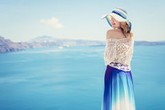 Woman enjoying the beauty of sea Royalty Free Stock Images