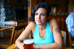 Woman enjoying a beer Stock Photo