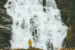 Woman enjoying big waterfall landscape view Royalty Free Stock Image