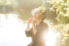Woman enjoying blooming tree stock photo