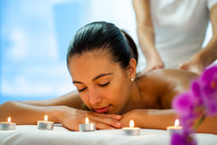 Woman enjoying body treatment in spa. Stock Image