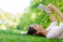Woman enjoying a book Stock Images