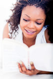 Woman enjoying a book Stock Photography