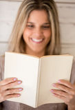 Woman enjoying a book Royalty Free Stock Image