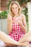 Woman Enjoying Bowl Of Breakfast Cereal Stock Photo