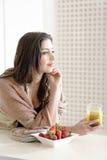 Woman enjoying breakfast Stock Photos