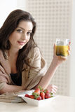 Woman enjoying breakfast Royalty Free Stock Photography